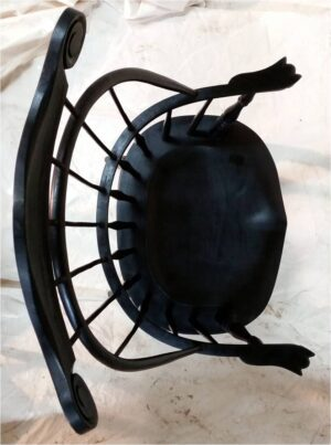 Top view of sack back chair with carved crest